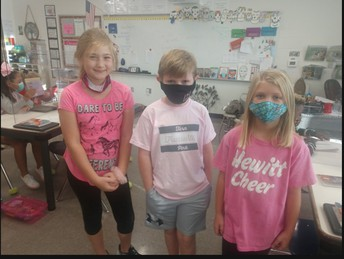 3 students wearing pink