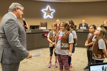 Parr Brownies leading the pledges at CCISD Board Meeting