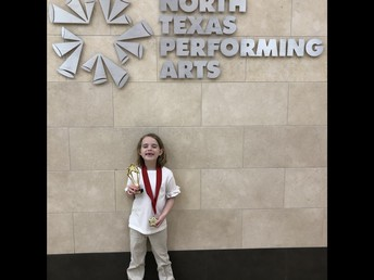 LPS first-grader, Audrey Thompson, received a trophy for her performance in Wizard of Oz.