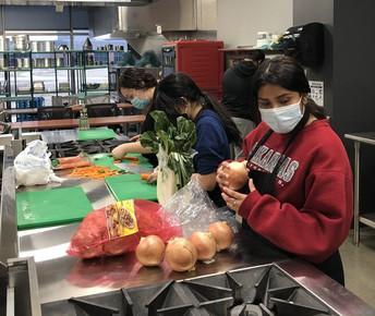 Culinary Team Preparing Orange Chicken