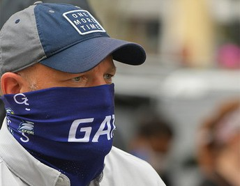 Coach Chad Lundsford, wearing a bandanna mask at the protest