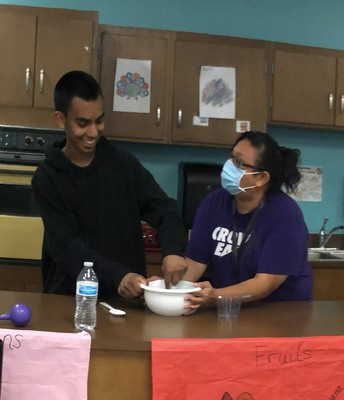 Stirring up a little something in the kitchen with Ms. Rodriguez.