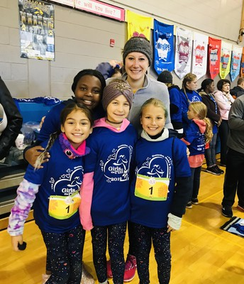 Ms Gordon with some of her Girls on the Run friends