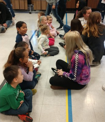 Making friends with Kindergarteners on a field trip for Arts Alive!