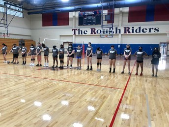 Freshman girls stand for a moment of silence on 9/11.