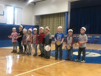 Kindergarteners play their instruments