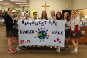Students walking and serving the community in Charity and Truth!