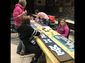 Madisyn Bridinger works on a welcome sign