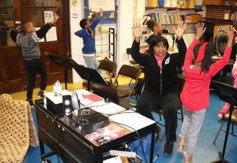 Normandy music teacher Suzanne Palmer perform a routine with her class at Jefferson Elementary School.