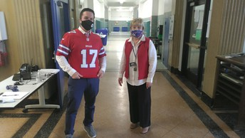 Staff dressed in Buffalo Bills clothing