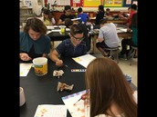Art students being creative with water colors.