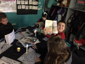 "Ms. Job's class reads by ""candle light"""