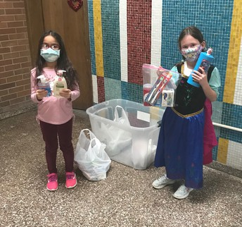 Students holding hygiene drive products