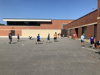Fifth graders Outside Looking at Shadows and the Sun