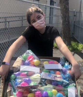 Lucia, our Student Council President, giving out eggs! Thanks!!