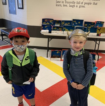 two students in hats