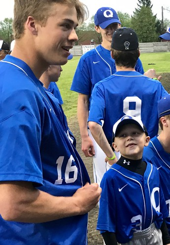 Young boy battling cancer embraced by QCHS baseball team and community