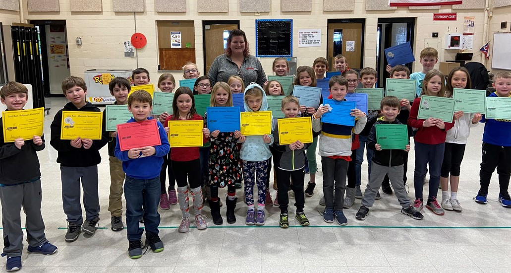 Student recipients of Just Run certificates at Munson Elementary