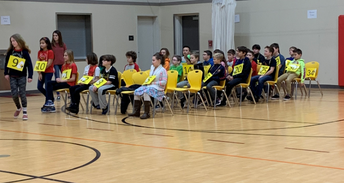 Patient contestants waiting for their turn in the Spelling Bee!