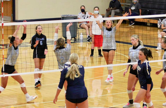 More Volleyball - look for Football pics soon!