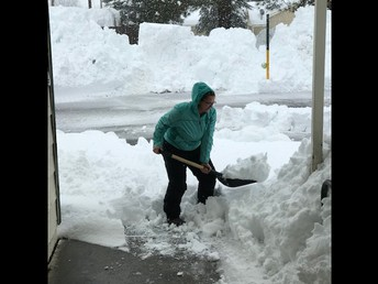 Ms. Shellie shoveling snow to get school ready and safe for students!