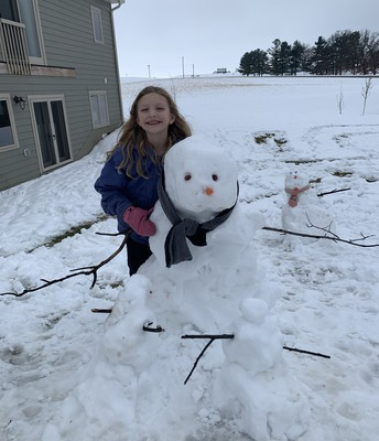 Abby building a snow family!