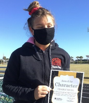 Teagan holding her Character certificate