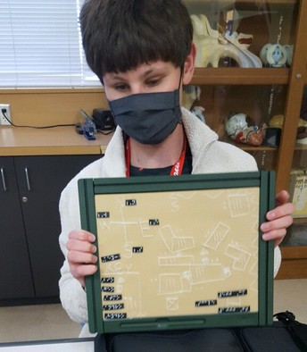 Student showing his tactile map