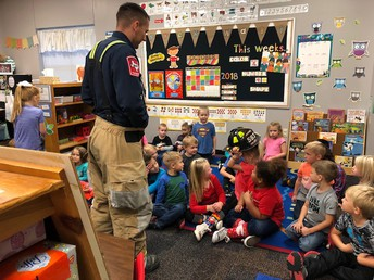 Pre-K classes learn about firefighting from Riley Thomas.