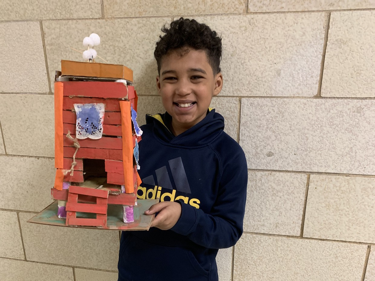 Student sharing his art project from Lawrence school.