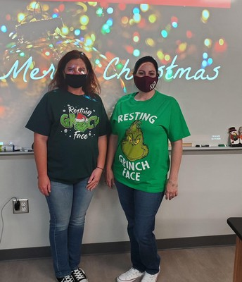 Mrs. Bushman and Mrs. Pennington have their grinch faces on!!