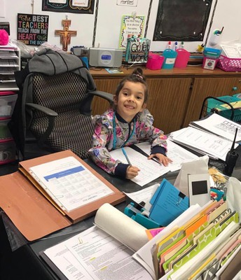 Ava Hernandez Looks like a Natural behind Mrs. Pfaff's Desk