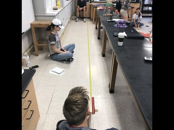 Physics students use lab equipment to learn about motion!