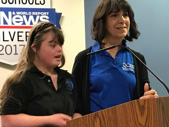 Elizabeth Alvino and one of her top students, Laini Ferrell, address the School Board.