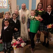 Father Wagner and our Flower Bearers at Mass for La Virgen de Guadalupe!
