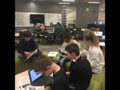 Students researching biographies for guided inquiry