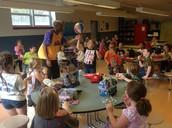 'Rocket' teaching a 2nd grader a basketball trick at lunch!