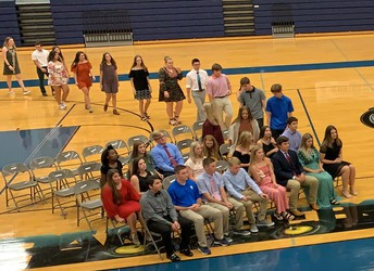 NHS inductees enter the ceremony