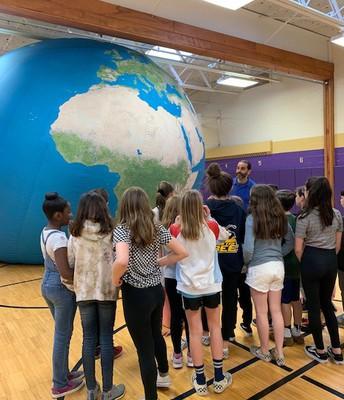 "Students navigating ""around the world"""