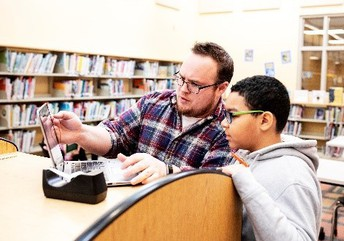 Teacher instructing student