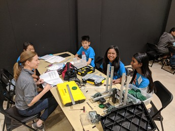 Team Pioneer is interviewed by Mrs. Williams, TUSD Robotics Lead, to improve their competition readiness.