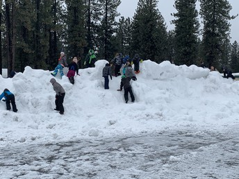 CES students love playing on the snow hills!
