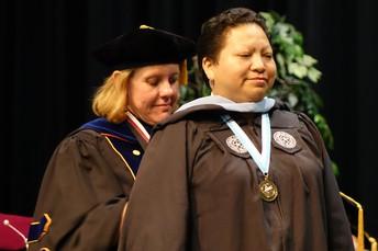 Dr. Wilson hoods Debra Martin