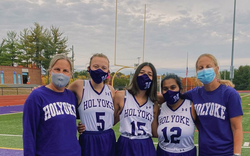 HHS Field Hockey honoring their seniors at practice.