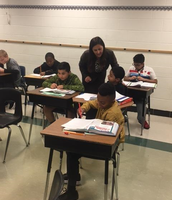 Ms. Gjelaj checking in with students