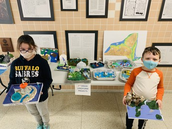 Students holding landform projects