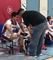 Coach Lopez gives his Center Robert a pep talk!