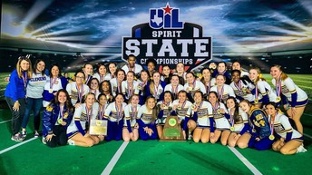 image of cheer squad & coaches posing with medals & trophy
