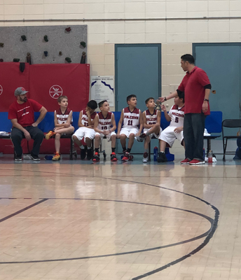 Coach Lopez encouraging our Falcons!