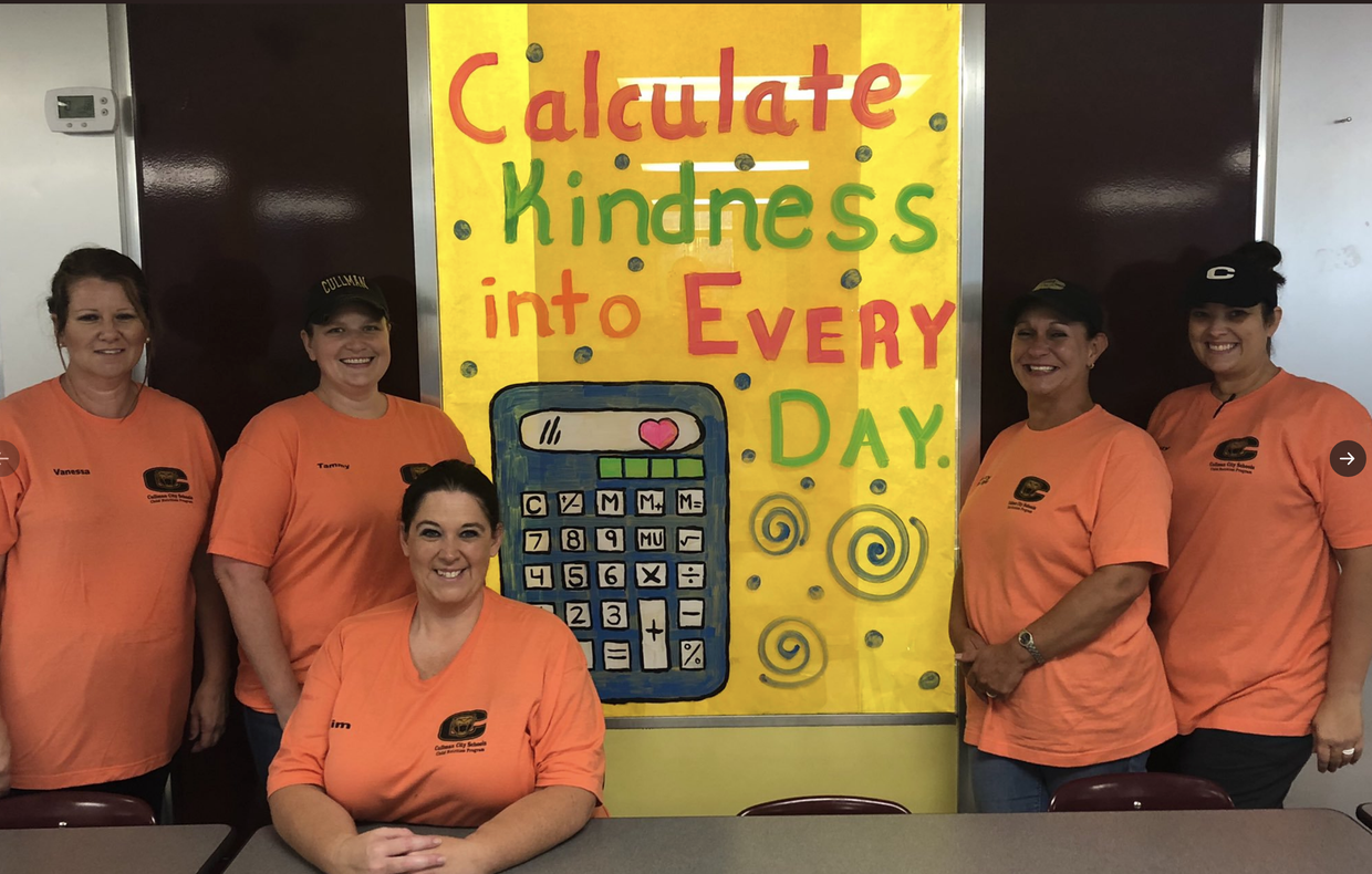 EES CNP staff with display about kindness.